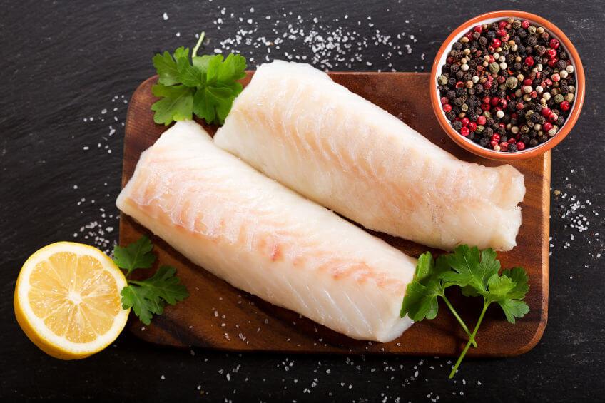 fresh fish, salt, pepper and half a lemon