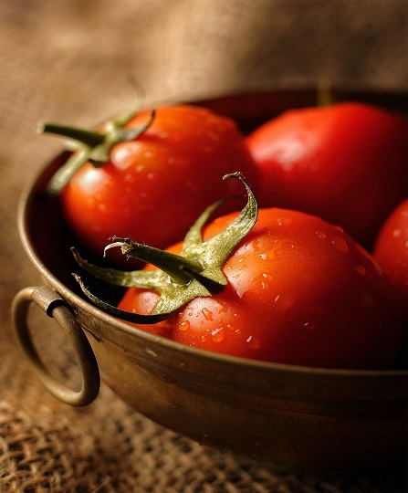 tomatoes in a brown bowl